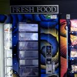 Vending machines with an assortment of chips and soda