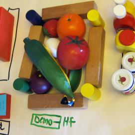 Toy grocery items are used to model food shopping