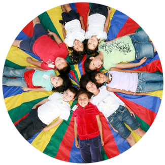 Schoolchildren laying on the ground in a circle